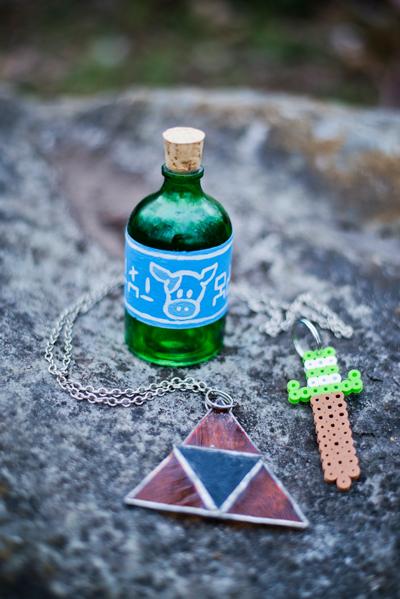 Zelda items treasures spoils lon lon milk bottle jug triforce necklace stained glass sword keychain