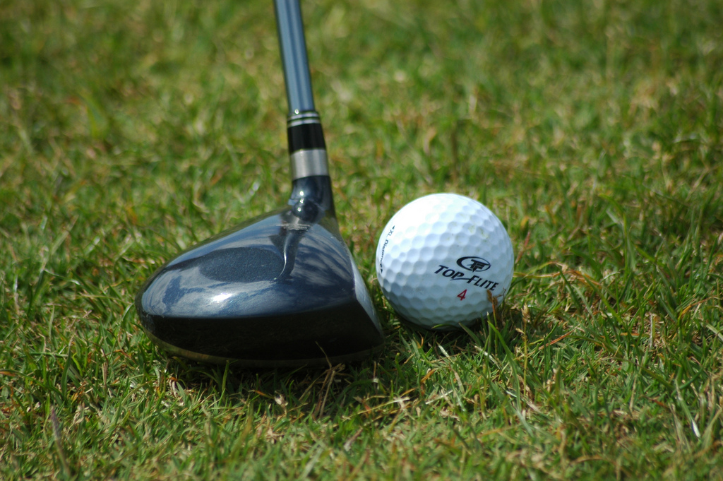 golf club and ball by Wojciech Kulicki