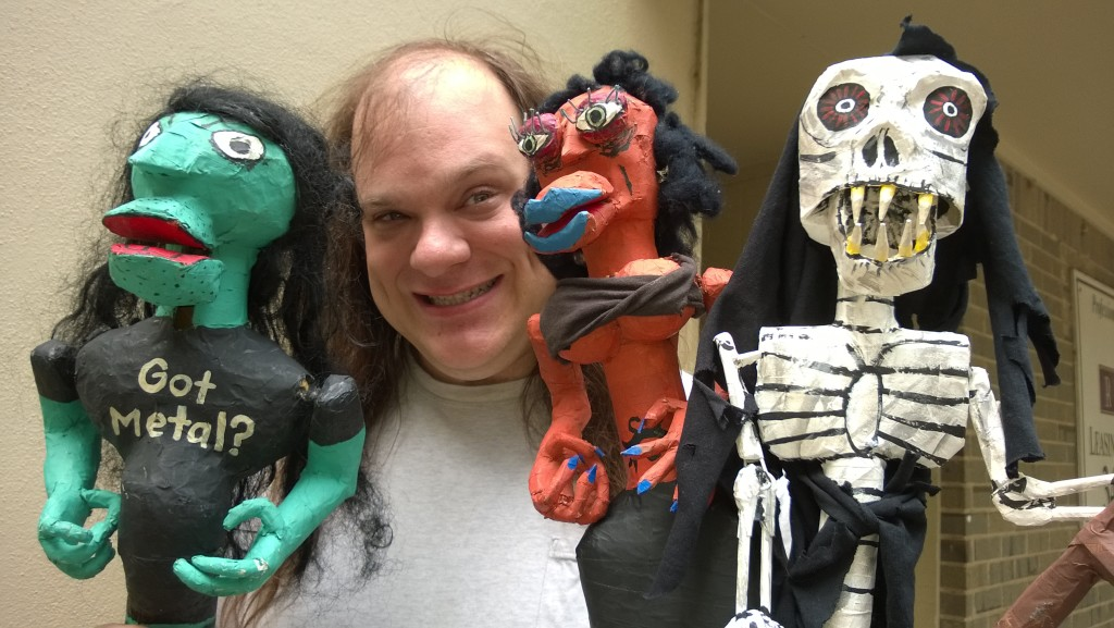 Ross Wilsey with some of his puppet stars.