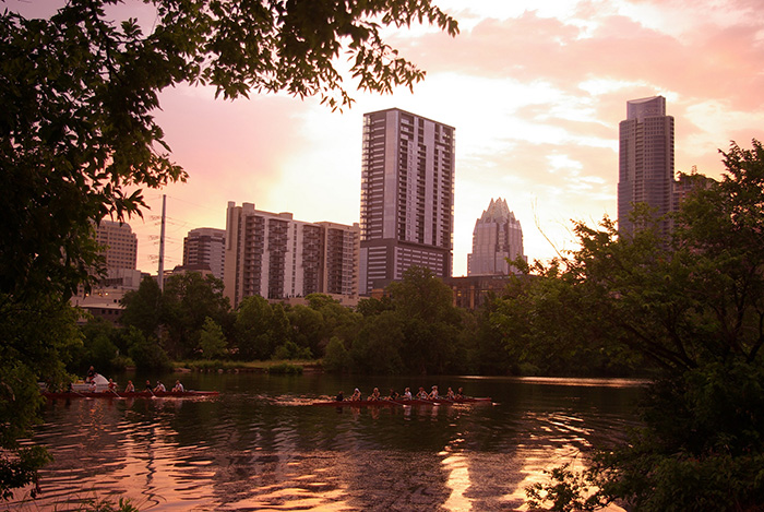 sunrise lady bird lake town lake rowers rowing reflection water