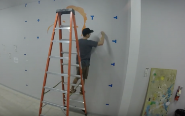 Watch This Local Artist Bring a Woman to Life at Crux Climbing Center