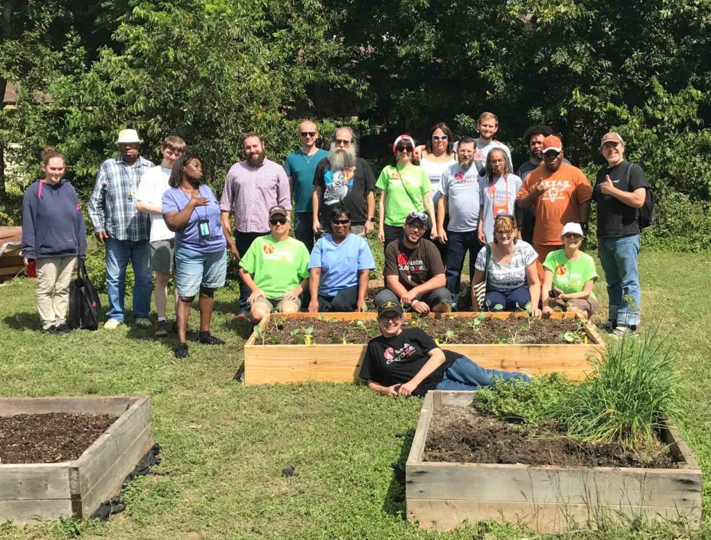 Clubhouse members are able to plant, grow, and harvest vegetables in the center's community garden.