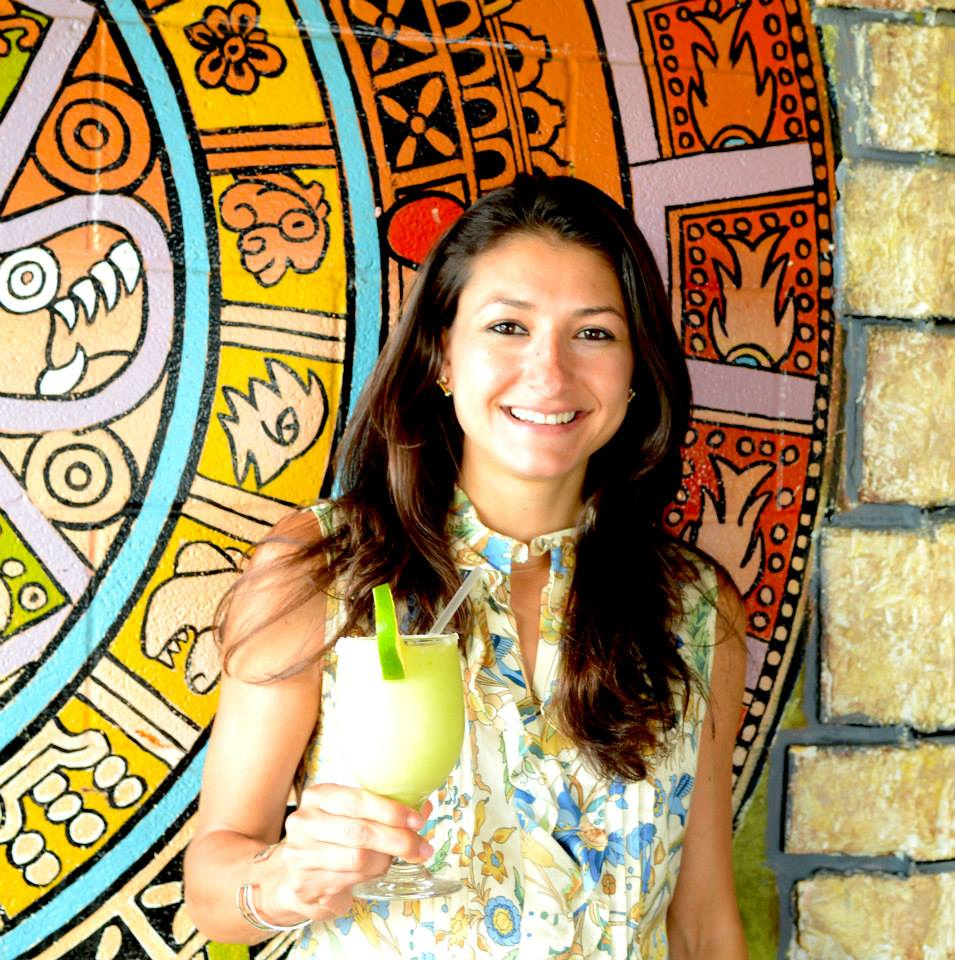 woman holding an avocado margarita at Curra's Grill in Austin