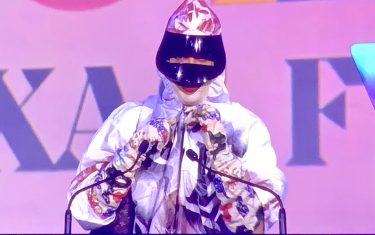 Erykah Badu Wears Louis Vuitton Hazmat Suit At Texas Film Awards