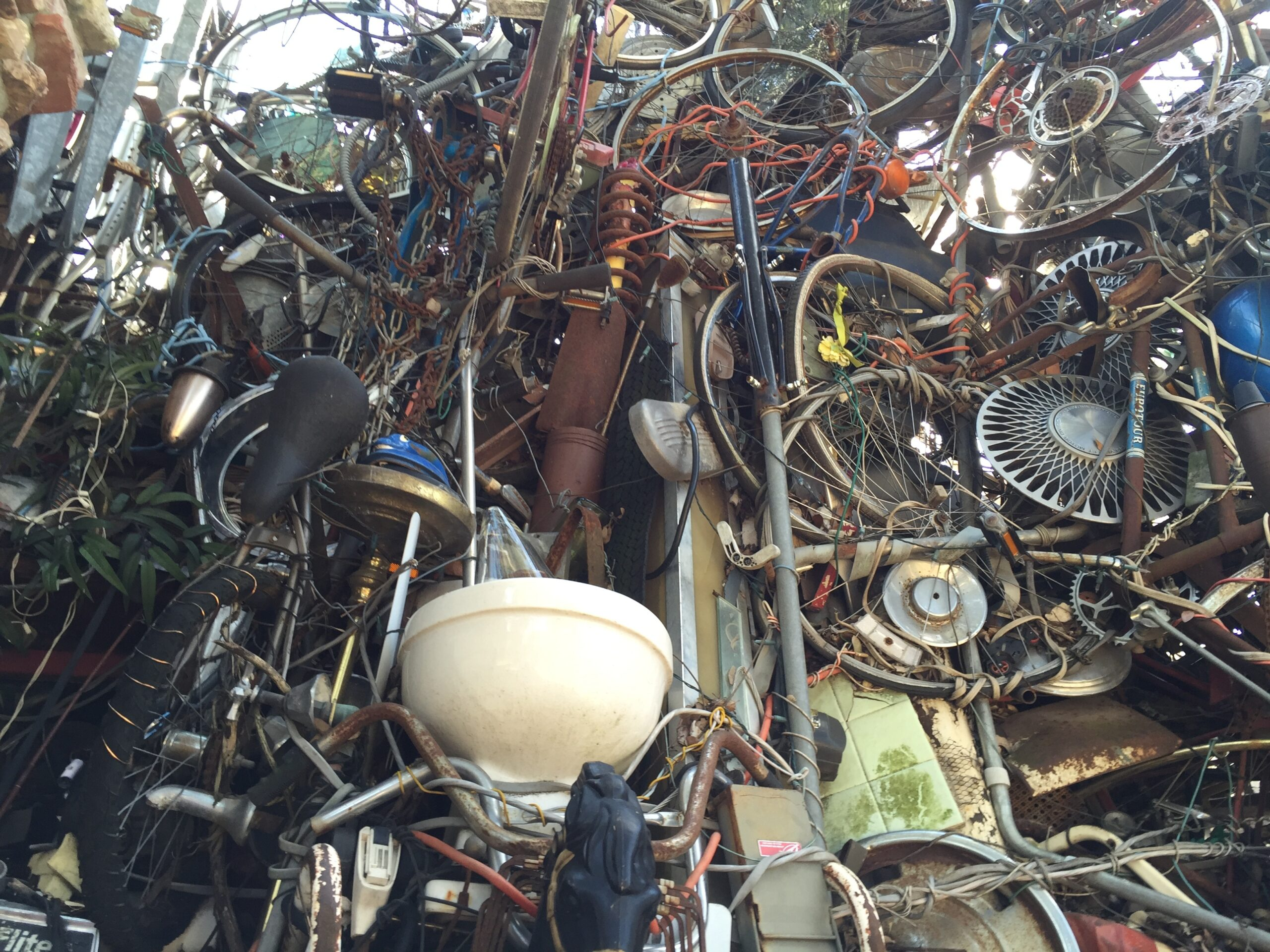 Cathedral of Junk - A wall of bicycles, wheels...and a toilet